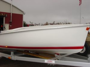 white boat w/ red stripe